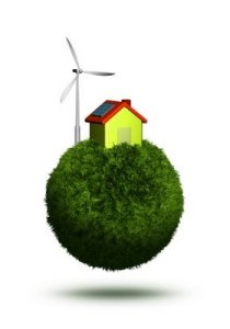house on green grass earth with wind generator